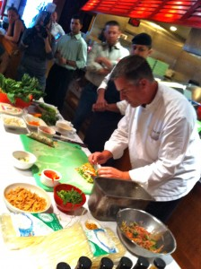 Big Bowl Executive Chef Marc Bernard demonstrates summer roll making